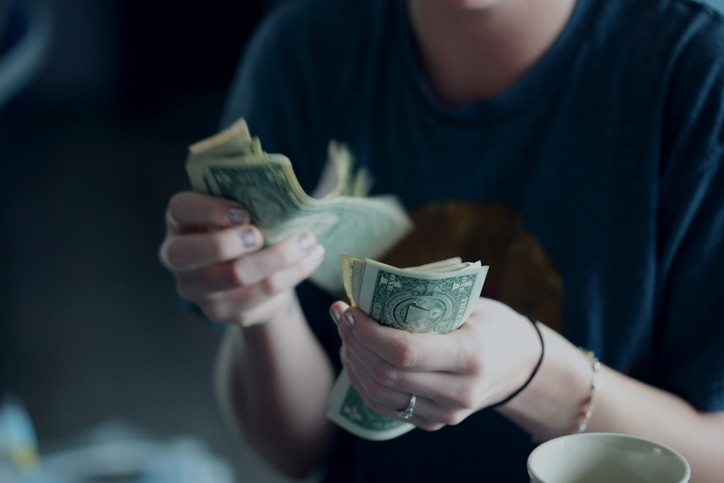 woman counting cash in hand
