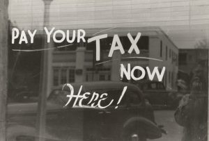 old photo saying pay your tax here now